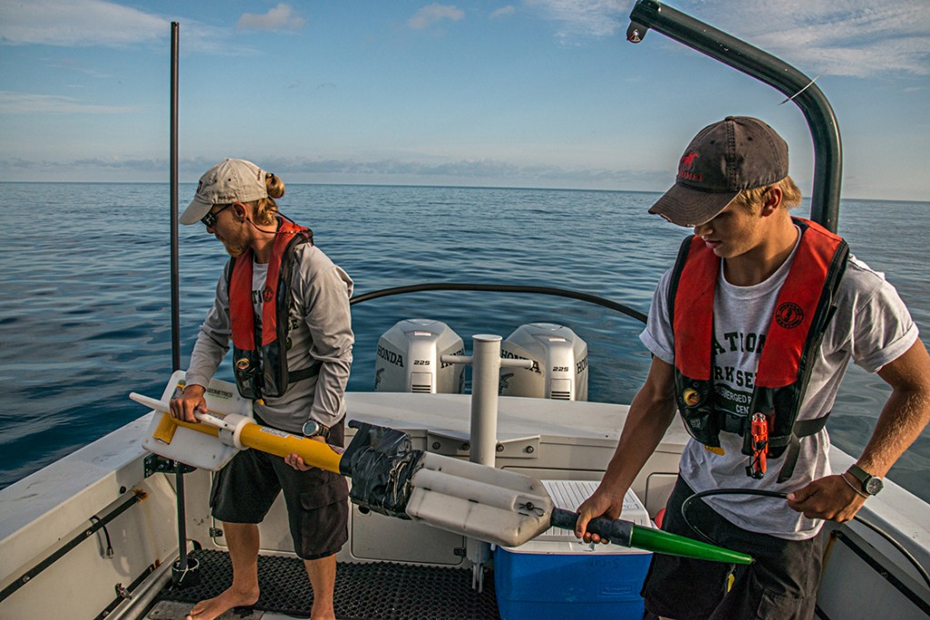Volunteer Dylan Hardenberg and I prepare to launch the magnetometer off of the back of the SRC's research vessel Cal Cummings. Photo credit to Susanna Pershern