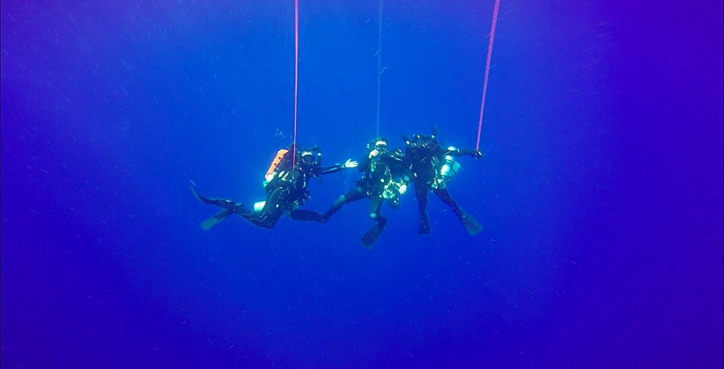 After coming up from their dive to 220ft, the SRC had plenty of time to decompress. They had to spend over a 30min just at 20ft to decompress safely. Notice the lack of bubbles? CCRs recirculate air back into the mix. From left to right: Dave, Steve, and Brett.