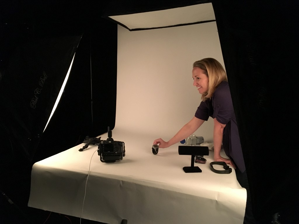 Scuba Diving's photo editor, Kristen McClarty, holds a dive computer to be photographed.
