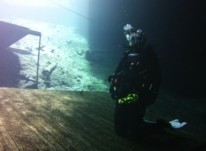 Kneeling on a platform at Blue Grotto Dive Resort in Williston, FL. Photo By Robby Myers.
