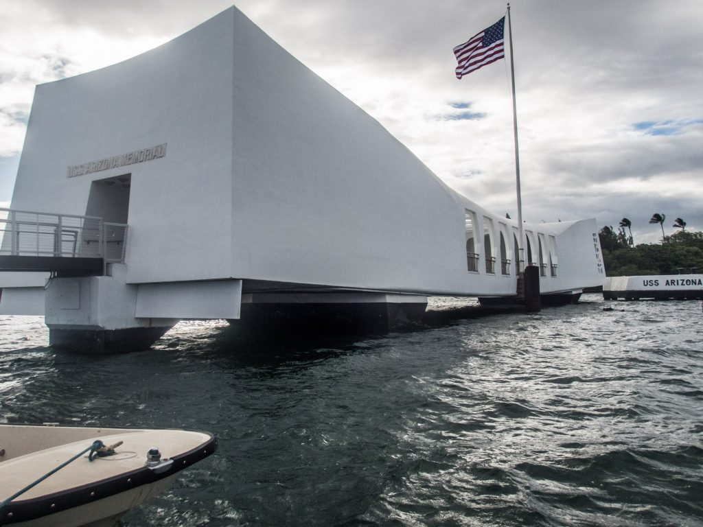The USS Arizona Memorial straddles the mid-deck of the ship.