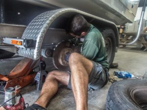 Ian removes the caliper in order to examine the old break pads
