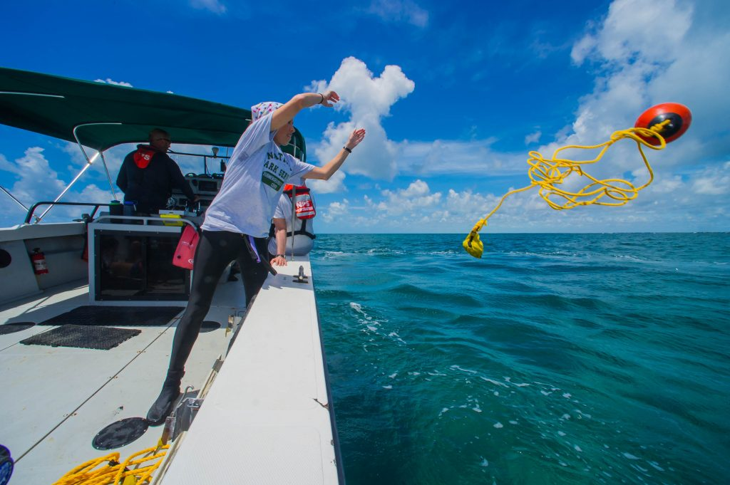 Rachel Kangas, Florida Public Archaeology Network team member, throwing a buoy to mark an anomaly.