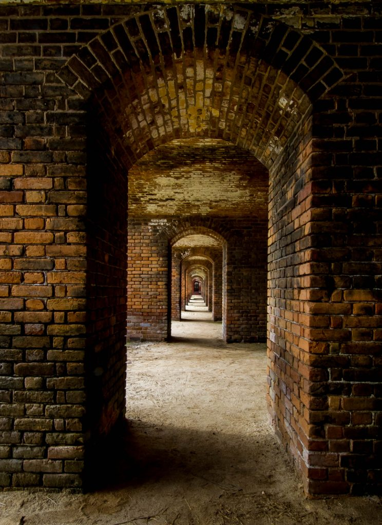 Wandering through the arches within the walls of Fort Jefferson.