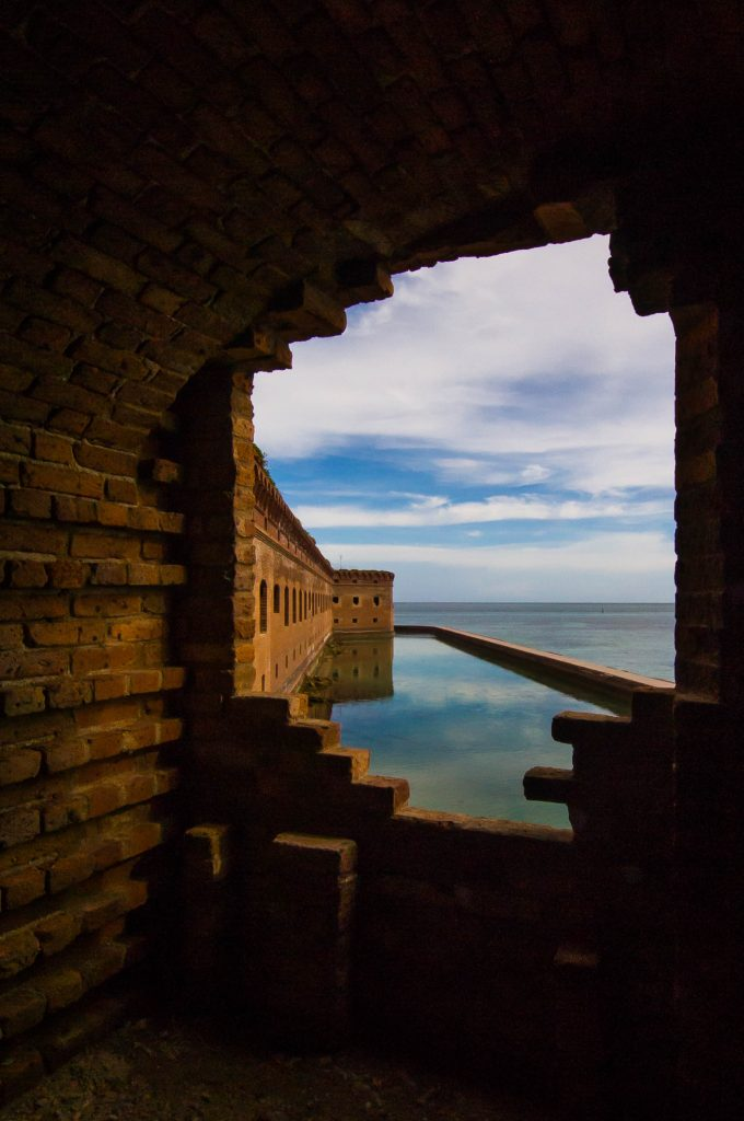Looking through a cannon opening at Fort Jefferson. The moat below used to be home to a crocodile.