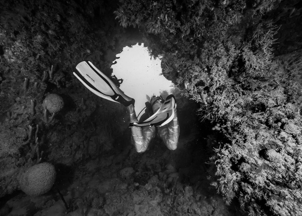 Lee explores the caves of our dive site.