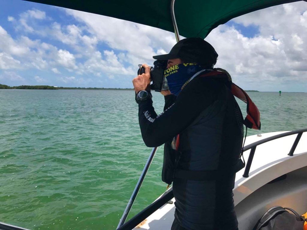 Me trying to get the shot and stay out of the sun! Photo credit: Susanna Pershern, Submerged Resources Center, National Park Service.