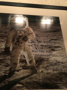 A signed photo of Buzz Aldrin is one of many snapshots hanging on the staircase walls at the Explorer's Club